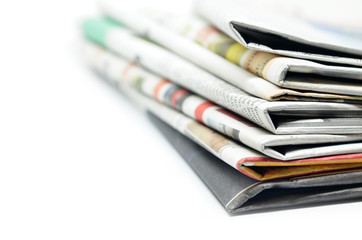 Newspapers folded and stacked