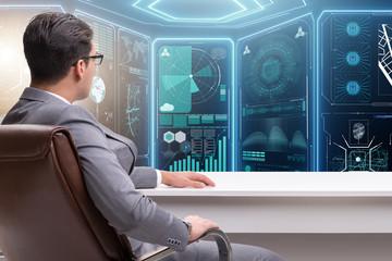 Businessman in futuristic computing concept
