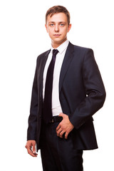 Young handsome businessman in black suit is standing straight, portrait isolated on white background