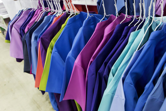 Row of nurse uniform' hanging