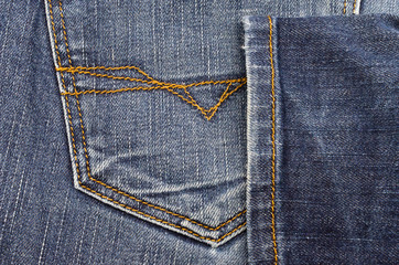 Pocket of jeans with yellow beads