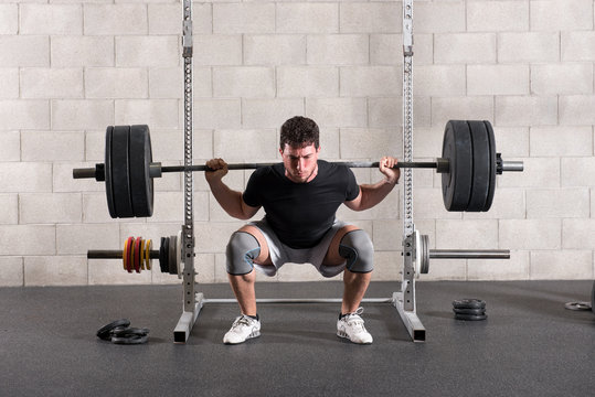 Man doing a crossfit back squat exercise
