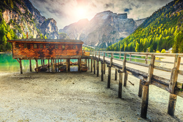 Wall Mural - Wooden boathouse and boats on the alpine lake, Dolomites, Italy