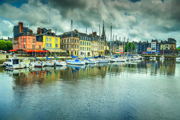 Traditional houses and boats in the old harbor, Honfleur, France Fototapete
