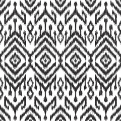 Vector illustration of the black and white colored ikat ornamental seamless pattern. Scribble texture.
