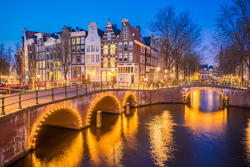 Wall Mural - Night view of Amsterdam city skyline at night in Netherlands