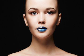 Young woman face.Beautiful Girl with blue lips