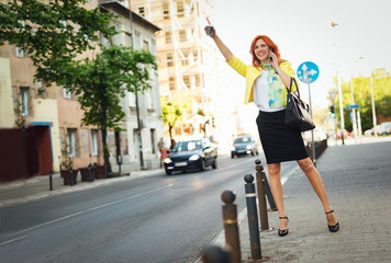 Smiling Businesswoman Hailing Taxi