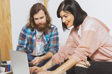 Hipster couple working at the office