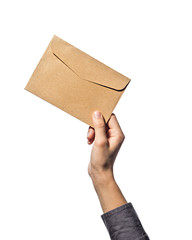 Hand holds an envelope, on a white isolated background.