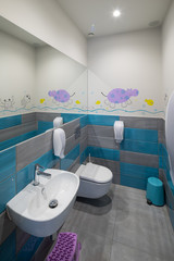 Modern toilet interior. Kid's toilet.