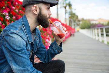 Man drinking a fresh beverage