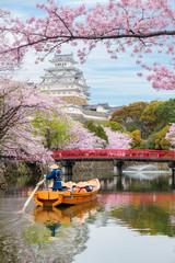 Himeji Castle with beautiful cherry blossom in spring season at Hyogo near Osaka, Japan. Himeji Castle is famous cherry blossom viewpoint in Osaka, Japan.