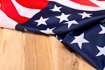 The Flag Of The United States Of America. American flag on a light wooden background. The view from the top.Happy holiday USA.