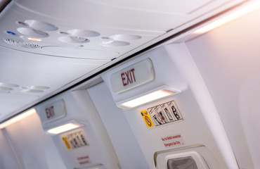 Aviation safety, Emergency exit sign on plane