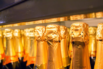 Close up champagne bottles in supermarket