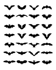Big set of black silhouettes of bats on a white background