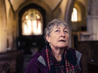 Senior woman exploring church