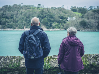 Senior couple admiring view of river