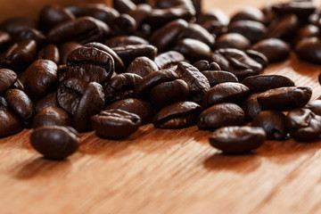 Roasted coffee beans espresso with a wood background