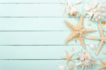 seashell and starfish on the wooden board
