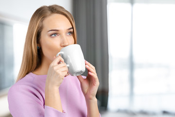 Beautiful girl with a  cup
