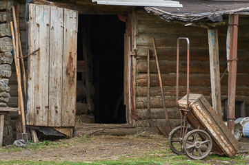 Old cart costs against a shed.