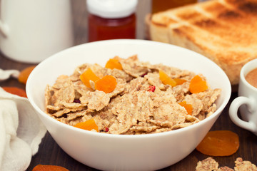 cereals with dry fruits in bowl and jam