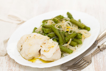 boiled fish with green beans on white dish