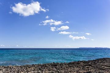 Coastline, sea, island, sky and clouds