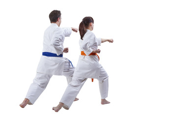 Husband and wife sportsmen beat a punch hand against a white background