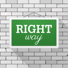 Simple green sign with text 'Right Way' hanging on a gray brick wall. Grunge brickwork background, textured rough surface. Creative business interior template for web, shop, store, supermarket.