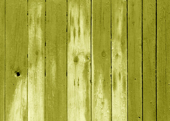 Wet yellow color wooden fence pattern.
