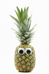 pineapple with googly eyes on white background