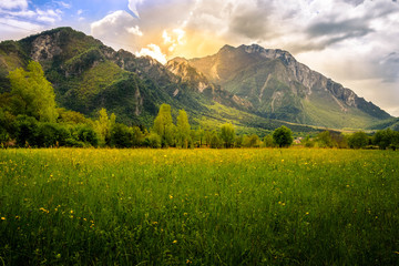 Spring landscape from meadows in Venzone, Italy, with beautiful mountains in the background.