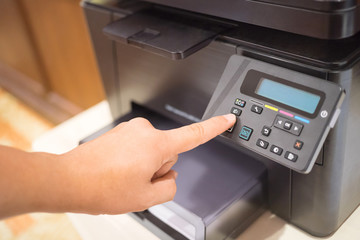 Copier Start, Finger pressing the start button on multifunction printer or copier