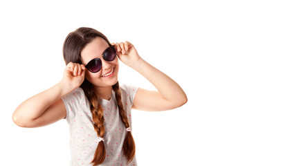 Portrait of the young stylish girl over the white background