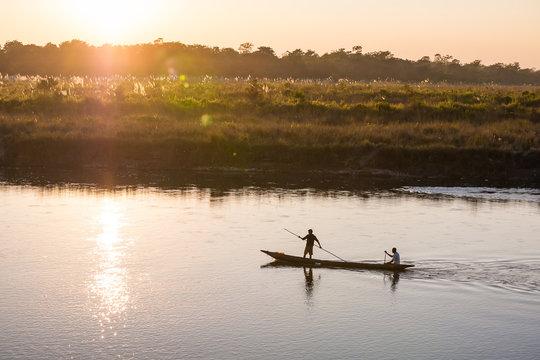 November 17, 2013 - men are fishing on Rapti river at the border of Chitwan national park, Nepal