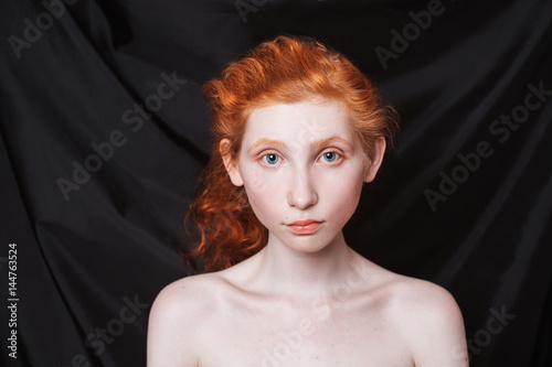 Woman With Long Curly Red Hair Gathered In Ponytail On Black Background Haired