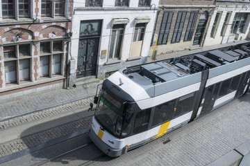 Modern tram car and the medieval houses in the city of Ghent, Belgium.  View from the wall of the Gravensteen castle.