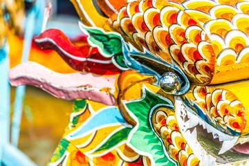 Multicolored face of vietnamese dragon.