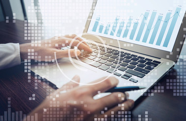 Young businessman working with digital screen on laptop with diagram graph.Business technology connectivity.strategy planning.research information data