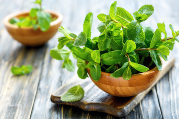Mint leaves in wooden bowls.