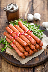 Sausages on wooden background