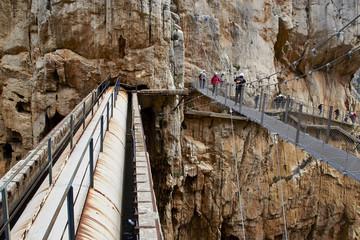 Wall Mural - People walking over the suspension bridge of Caminito del Rey, Garganta del Chorro
