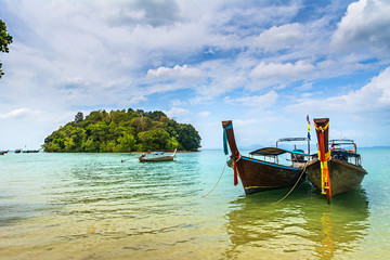Amazing view of beautiful beach with longtale boats. Location: Krabi, Thailand, Andaman Sea. Artistic picture. Beauty world.
