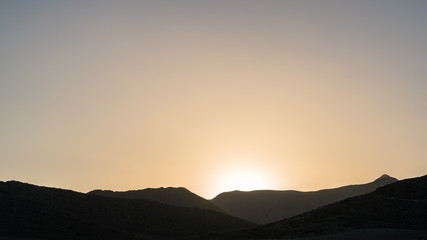 sunset over a dried plain an mountains