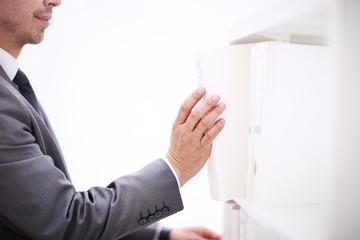 Maleoffice worker choosing white folder