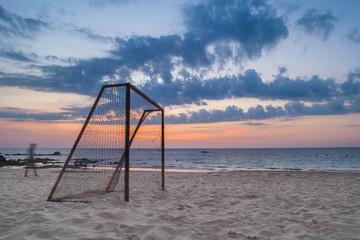 long exposure football goal on the beach in sunset
