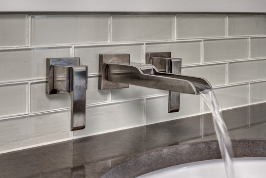 Water Runs from Bathroom Faucet